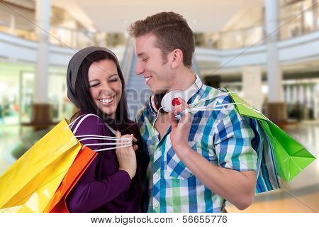 Young Couple Having Fun While Shopping In A Shopping Mall