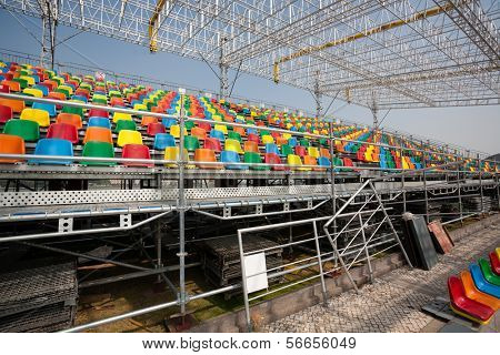 MACAU, CHINA - NOVEMBER 2, 2012: Construction of seats for spectators and preparation track for race Macau Grand Prix in stages Formula 3, FIA WTCC, motorcycle prize. Race takes place on the streets.
