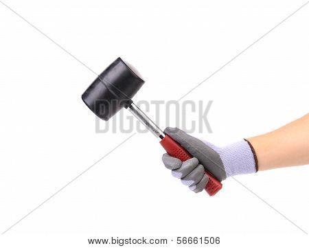 Hand holding hammer.