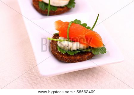 Smoked Salmon Roll On Pumpernickel Bread With Remoulade