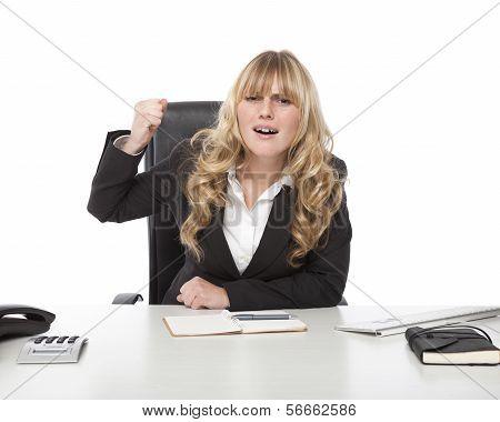 Businesswoman raising her fist in frustration