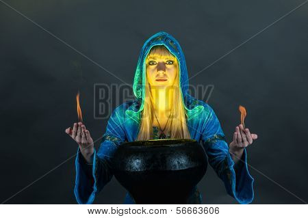 Witch with fire in hands
