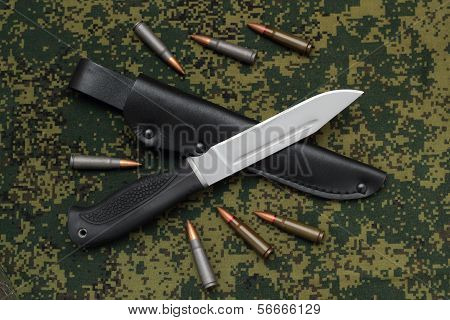 Military Knife Blade Up On Black Leather Sheath