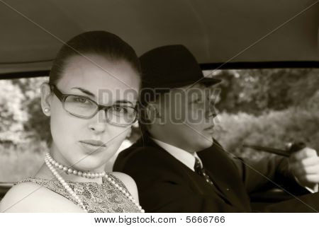 Girl And The Young Man Walk In A Car