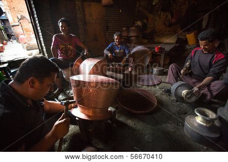 BHAKTAPUR, NEPAL - DEC 5: Unidentified Nepalese tinmans working in the his workshop, Dec 5, 2013 in Bhaktapur, Nepal. 100 cultural groups have created an image Bhaktapur as Capital of Nepal Arts.