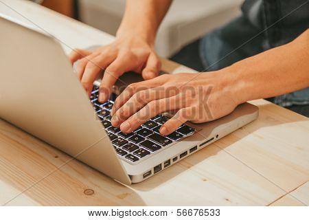 Man Typing On A Modern Laptop