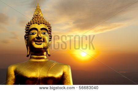 Golden Buddha statue on sunset at Saraburi. Thailand