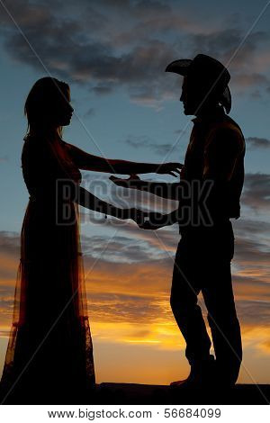 Couple Cowboy Reach To Each Other Silhouette