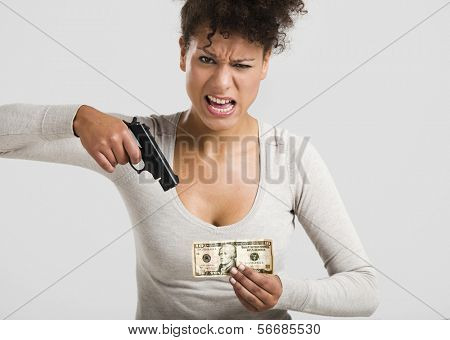 African woman shooting a US-Dollar banknote, great concept for the global crises