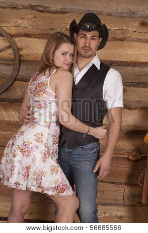 Cowboy With Woman Arms Around Him