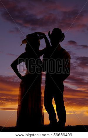 Silhouette Couple In Western Hats Together