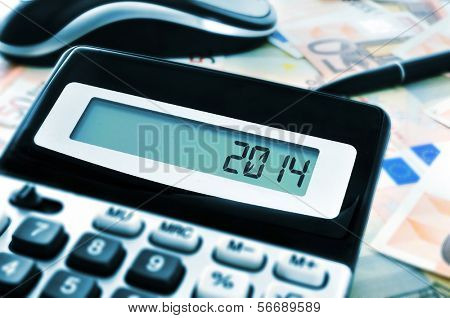 number 2014, as the new year, on the display of a calculator