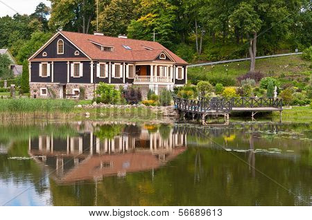 Big Family House in Front of the Lake in the Forest