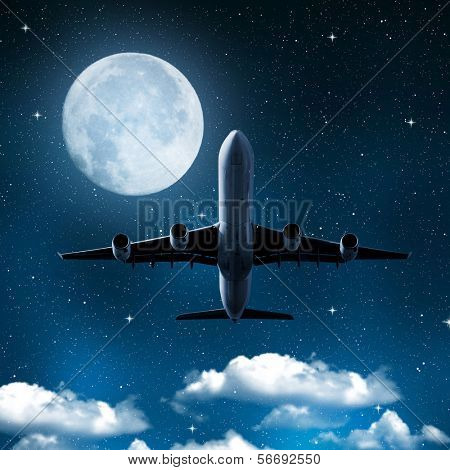 aircraft on night sky with moon