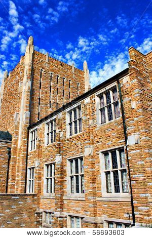 Large old building with bright blue sky at Tulsa University campus in Tulsa, Okla.