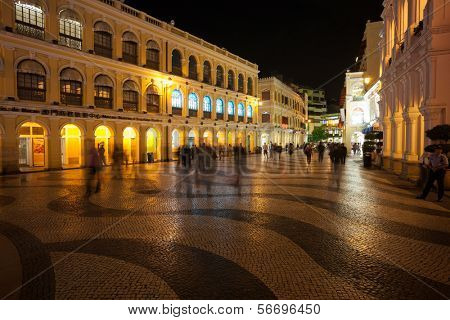 MACAU, CHINA - OCTOBER 31, 2012: Tourists visit the Historic Center of Macau - Senado Square. Historic Center of Macau was inscribed on UNESCO World Heritage List in 2005.
