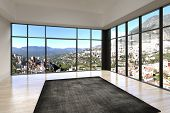 pic of penthouse  - Empty room interior with floor to ceiling windows and scenic view - JPG