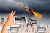 image of meteorite  - People taking photos of falling meteorite on mobile phone camera - JPG