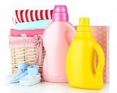 Softener dryers and washing powder with children clothes isolated on white