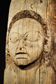 picture of tlingit  - Old Weathered Tlingit Totem Pole with Human Face located in Ketchikan Alaska Vertical - JPG