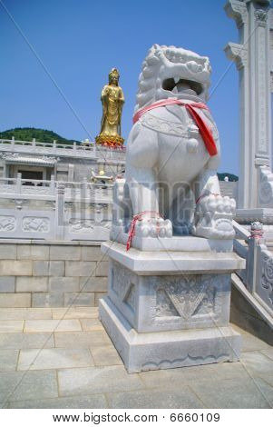 Statue of the goddess and lion in China. Dalian