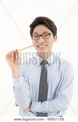 Asian male student with a pencil