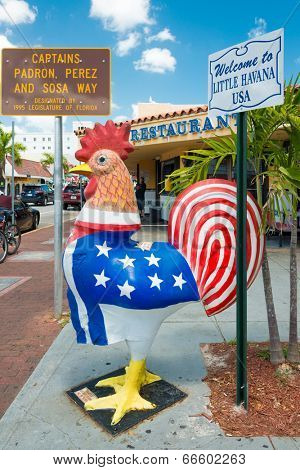 MIAMI,USA - MAY 19,2014 : Symbolic rooster sculpture with the colors of the cuban and the american flag at Calle Ocho , the focal point of the cuban community in Little Havana