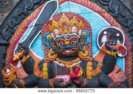 KATHMANDU, NEPAL - NOV 29, 2013: Kaal Bhairav statue at Basantapur Durbar square in Kathmandu. Largest city of Nepal, its cultural center, a population of over 1 mill people.
