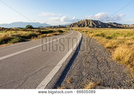 Asphalt Road Going to the Mountains