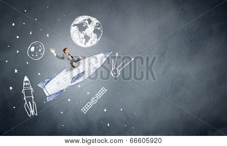 Young businessman,an flying in sky on drawn rocket