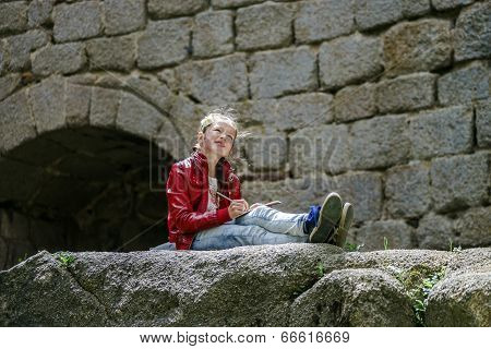 Teenage Girl Sitting And Painting