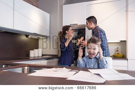 Furious child screaming and parents in a quarrel
