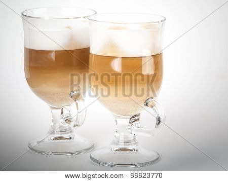 Two Glass Mugs With Handles Of Latte Coffee