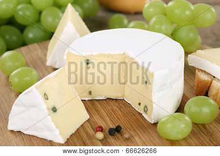 Soft Cheese Like Camembert Or Brie On A Wooden Board