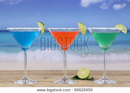 Martini Cocktails In Glasses On The Beach With Lemons