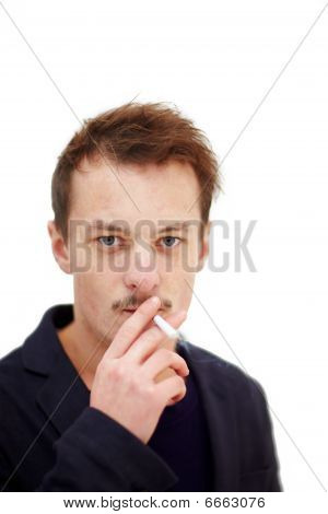 Modern Young Man Smoking A Deadly Cigarette