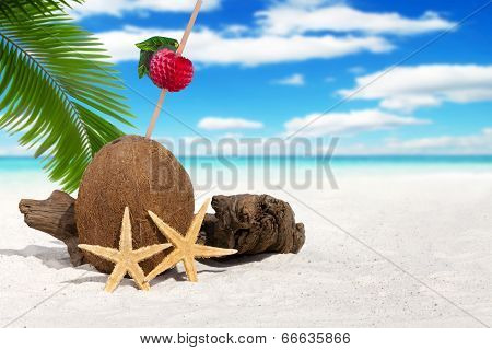 Coconut With Drinking Straw On The Beach