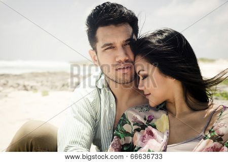 Portrait of a passionate young couple in love at the beach - soft vintage look