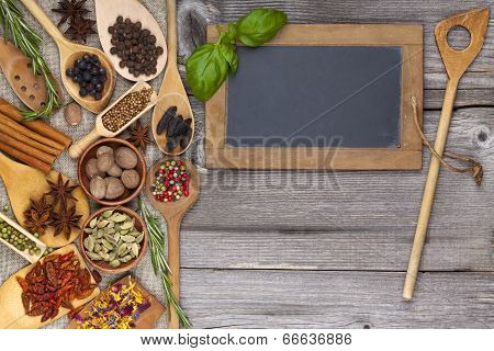 Herbs And Spices On Rustic Wooden Background