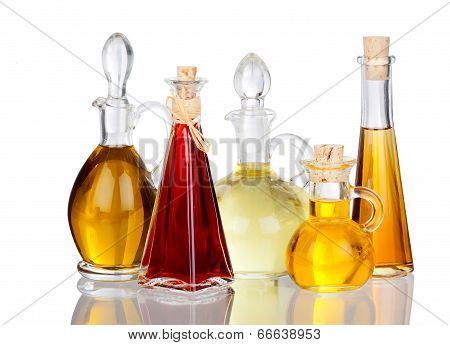 Various Cooking Oils In Glass Carafes With Real Reflection