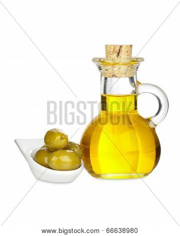 Glass Carafe With Olive Oil And Olives In A Bowl