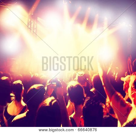 a crowd of people at a concert done with an instagram like filter