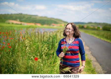 Middle Aged Woman With Cornflowers And Poppies