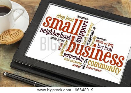 small business word cloud on a digital tablet with a cup of coffee