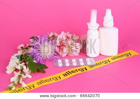 Allergenic plants and medical drugs on pink background