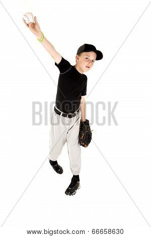 Young Boy In Uniform Pitching A Baseball Right Handed