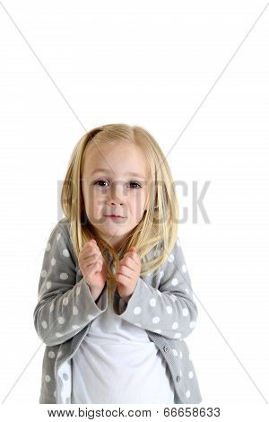 Young Blond Girl With Funny Expression Shrugged Shoulders