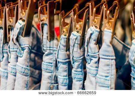 Jeans Iron Clothespins Hanging In The Closet