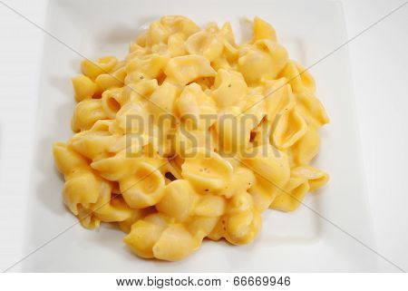 Macaroni And Cheese Served On A Small Plate