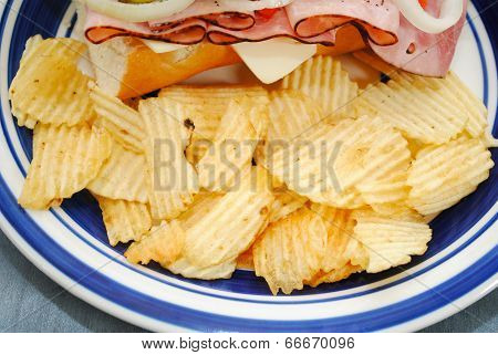 Ruffled Potato Chips Served With A Sandwich